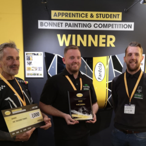 Elliot accepting prize with Sponsor (Danny) and Father (Darran) at Advanced Engineering
